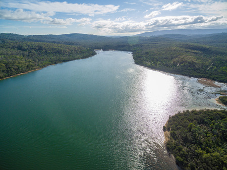 Aerial view of Lysterfield lake with surrounding forest. Melbourne, Victoria, Australia