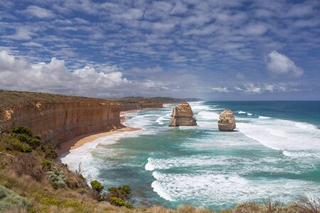 Two of the Twelve Apostles rocks on  Great Ocean Road, Australia at high tide with big waves