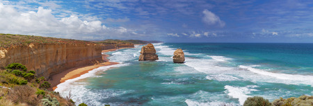 Panorama of two of the Twelve Apostles rocks on  Great Ocean Road, Australia. Midday and high tide.