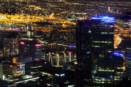 southbank: Melbourne, Australia - August 27, 2016: Aerial nightscape of the City with skyscrapers and glowing streetlights