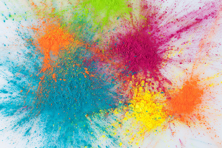 color explosion concept colorful holi powder exploding on white