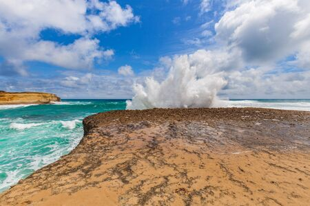 Big wave breaks on a rock with explosion like splashes, Great Ocean Road, Australia Stock Photo