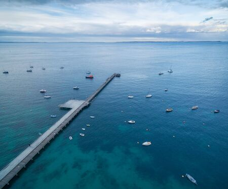 flinders: Aerial view of Flinders pier with moored fishing boats at dusk, Mornington Peninsula, Melbourne, Victoria, Australia Stock Photo