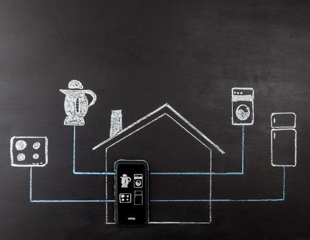 temperature controller: Smart house concept hand drawing on chalk board. Mobile phone controlling home appliances. Horizontal image with copy space.