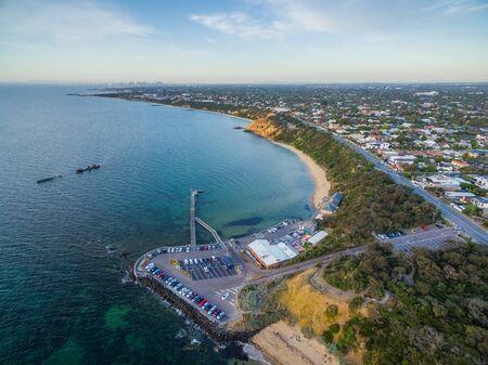 Melbourne, Australia - Aerial view of Black Rock pier, yacht club, and historic shipwreck of HMVS cerberus at sunset. Melbourne. Victoria, Australia