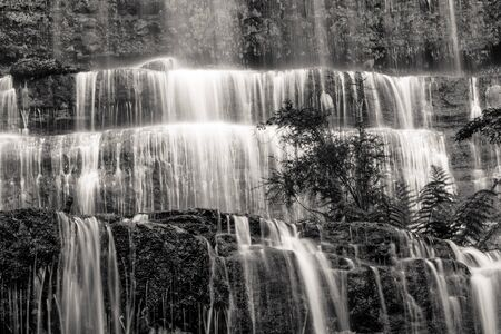 Famous Russell Falls closeup in black and white. Mount Field National Park, Tasmania, Australia