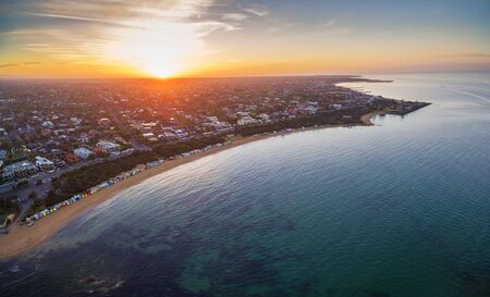 brighton: Aerial view of sunrise at Brighton Beach showing the suburb and bathing boxes. Melbourne, Victoria, Australia Stock Photo