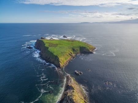 Aerial view of Courts Island - a small piece of land near Bruny Island Lighthouse, Tasmania, Australia.