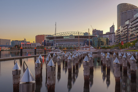 Melbourne, Australia - Feb 21 2016: Etihad Stadium viewed from Docklands waterfront with Yachts and bollards