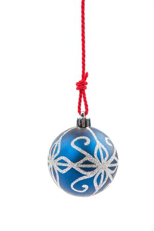 Christmas bauble hanging on a string isolated on white. Stock Photo