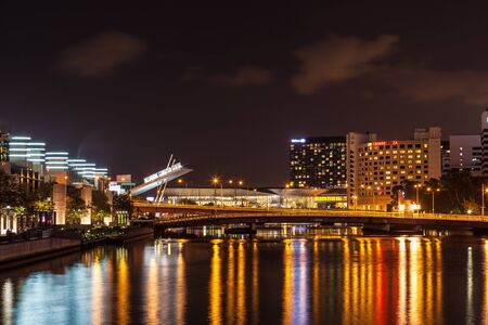 Melbourne CBD - APR 16 2016: Nightscape with Melbourne Exibition Centre sign and light reflections in Yarra River Editorial