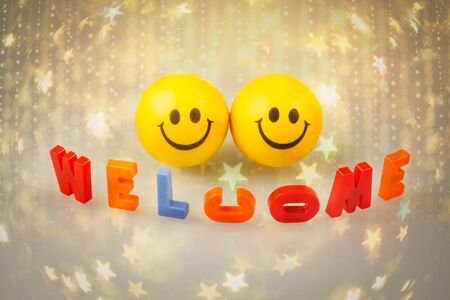 Welcome sign with two smileys.