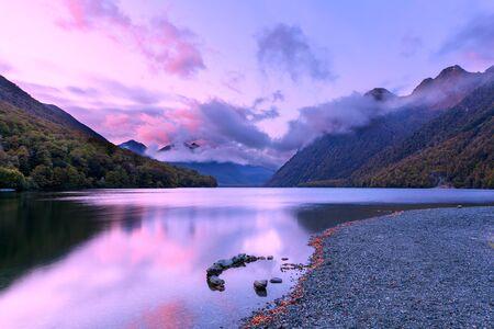 Lake Gunn at sunrise with reflections, Fiordland, South Island, New Zealand Stock Photo