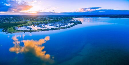 suburbia: Aerial panoramic landscape of beautiful Westernport Marina with moored boats and yachts at sunset