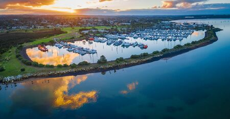 Aerial view of beautiful Westernport Marina with moored boats and yachts at sunset Stock Photo