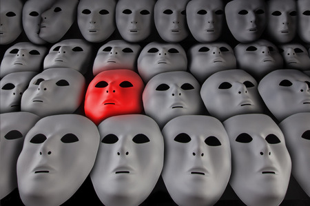 Glowing red face mask among many white masks on black background. Alone in the crowd concept