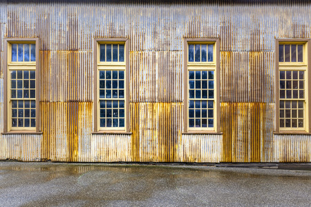 Old Rusty Metal Shed With Tall Windows Closeup Stock Photo   85753665