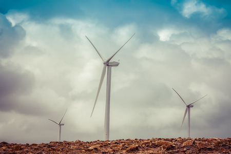 Renewable energy concept - wind turbines and stormy clouds