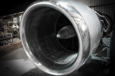 Extreme closeup of an old aircraft turbine engine on blurred background Stock Photo