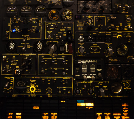 Control levers and switches with backlighting. Airplane cockpit. Stock Photo