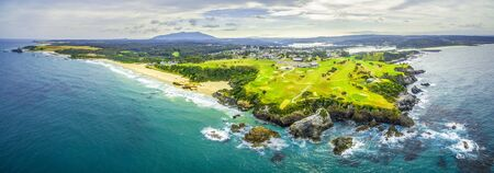 wales: Aerial panoramic view of ocean coastline near Narooma, NSW, Australia Stock Photo