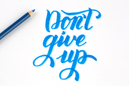 Dont give up - quote lettering in blue on white background