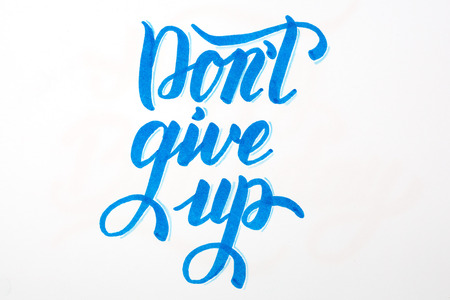 Dont give up - inspirational quote brush lettering in blue on white background