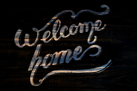 Welcome Home houten kalligrafie letters op zwart Stockfoto