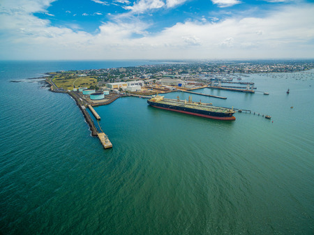 Aerial view of industrial docks and nautical vessel at Yarra river mouth. Williamstown, Melbourne, Australia