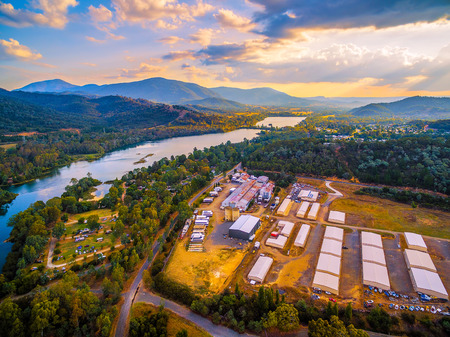Aerial view of river and industrial sheds at beautiful sunset in Australia Archivio Fotografico