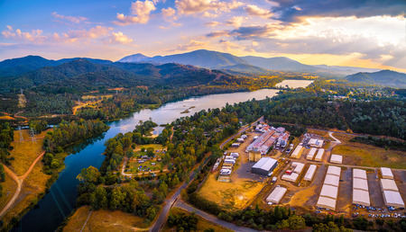 Aerial panorama of Goulburn River and mountains at sunset. Eildon, Victoria, Australia