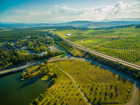 Aerial view of Tuggeranong Parkway passing near National Arboretum in Canberra, Australia Stock Photo