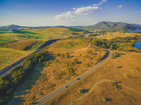 Aerial view of Tuggeranong Parkway and Lady Denman drive with iconic Telstra tower on the horizon. Canberra, Australia