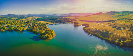 Aerial panorama of beautiful lake and countryside at sunset in Canberra, Australia Stock Photo