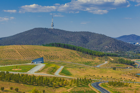 Landscape of  National Arboretum in Canberra, with iconic Telstra tower on Black Mountain. Canberra, ACT, Australia