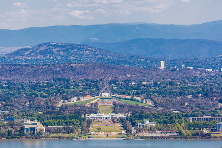 View of Parliament House with mountains on background from Ainslie Lookout. Canberra, ACT, Australia