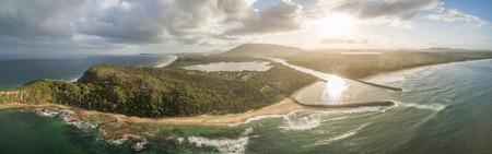Aerial panorama landscape of sunset over ocean coastline