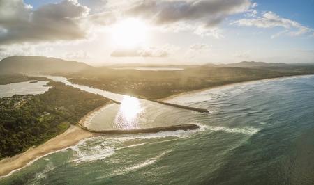 Aerial landscape of sunset over ocean coastline