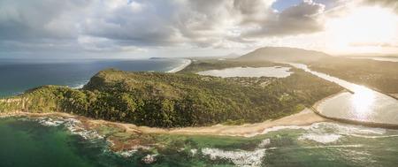 Picturesque aerial panorama of ocean coastline at sunset Stock Photo