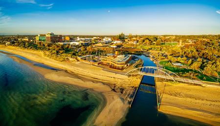 Frankston waterfront at sunset showcasing the famous footbridge over Kananook creek - aerial panorama. Melbourne, Australia Stock Photo