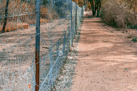 Electric fence with metal mesh in South Australia Archivio Fotografico