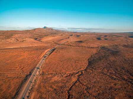 Aerial view of The Outback Highway passing through Flinders Ranges at sunset in South Australia