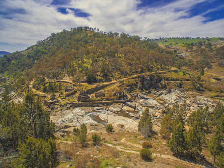 Adelong falls and gold mill ruins on bright sunny day, NSW, Australia