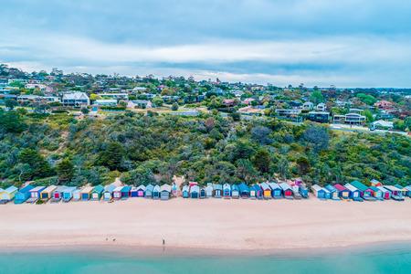 Aerial view of colorful beach huts on Mills Beach in Mornington, Victoria, Australia Фото со стока