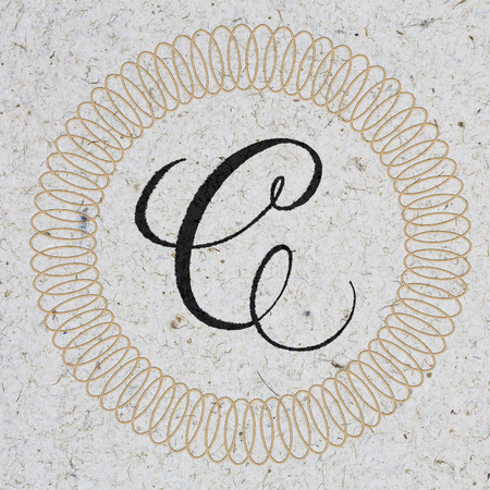 Letter C hand lettering monogram - ink on kraft paper with ornament