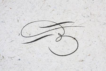 Beautiful flourish written in ink on kraft paper
