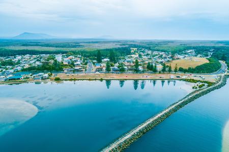 Aerial view of the long Harrington breakwall and township. Harrington, New South Wales, Australia Stok Fotoğraf