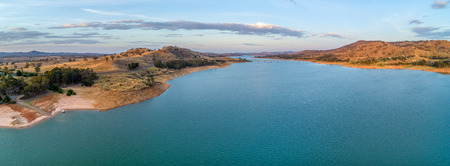Aerial panorama of Murray River and Lake Hume at sunset with copy space