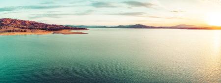 Scenic sunset over beautiful lake in Australia - aerial panorama 写真素材