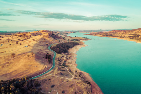 Aerial view of Riverina Highway along Lake Hume and Murray River at sunset. New South Wales, Australia